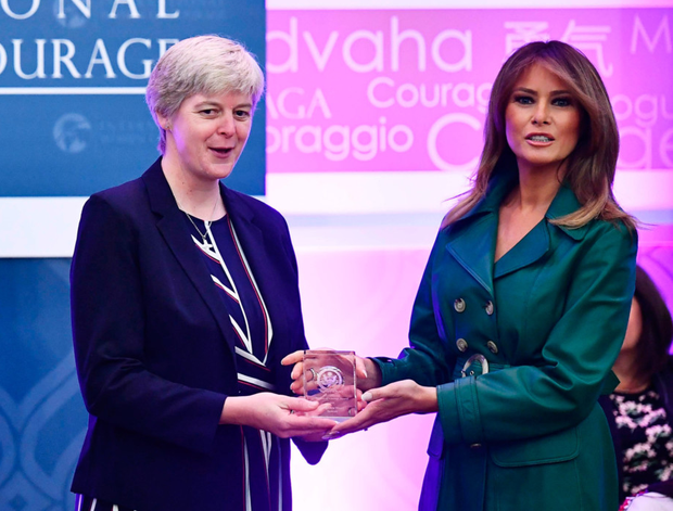 Sr Orla Treacy receives her award from Melania Trump. Photo: AFP/Getty Images