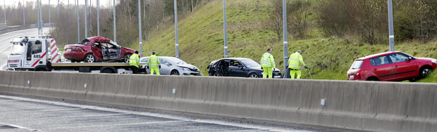 Gardai and forensic investigators at the scene of the fatal accident on the M6 near Kilbeggan yesterday