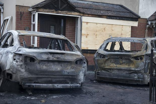 The burnt-out shells of the two cars in Clarehall