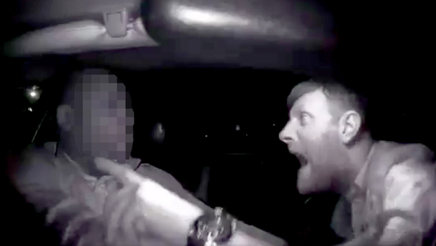 The suspected attacker can be seen racially abusing and assaulting the driver in his car