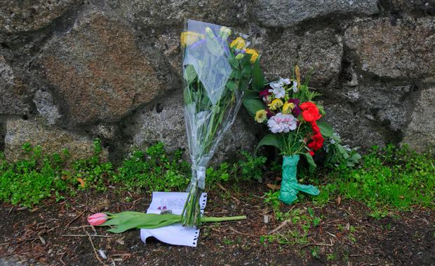 Flowers left at the scene. Photo: Collins Dublin, Gareth Chaney