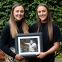 Twins Laura and Niamh Leacy holding a photo of their uncle Anton O'Toole. Picture: Caroline Quinn