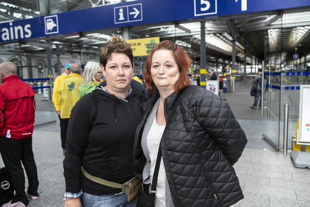 Lisa Hunter and Robyn Koch, from Wisconsin in America, pictured in Heuston Station yesterday during the travel chaos. Photo: Kyran O'Brien