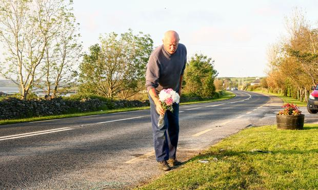 Peter Noonan places flowers at the scene of Limerick crash