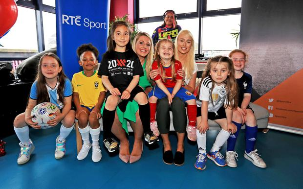 RTE presenter Jacqui Hurley, Ireland international Stephanie Roche and young supporters at the launch of RTE and TG4's coverage of the Fifa Women's World Cup. Photo: Donall Farmer