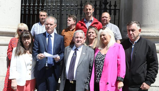 The Leech family outside the High Court with solicitor Mark Tiernan. Pic: Collins Courts