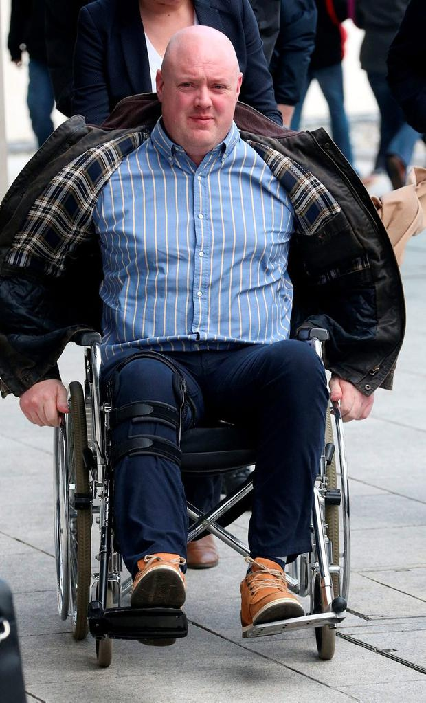 Gda Ciaran Murrihy attended court in a wheelchair in 2016. Photo: Collins