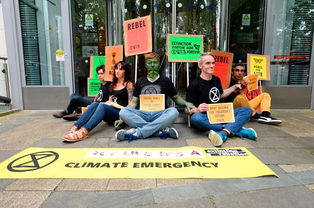 Members of Extinction Rebellion glue themselves together as they stage a protest at the Department of Communications, Climate Action and Environment in Dublin. Photo: Justin Farrelly/PA Wire