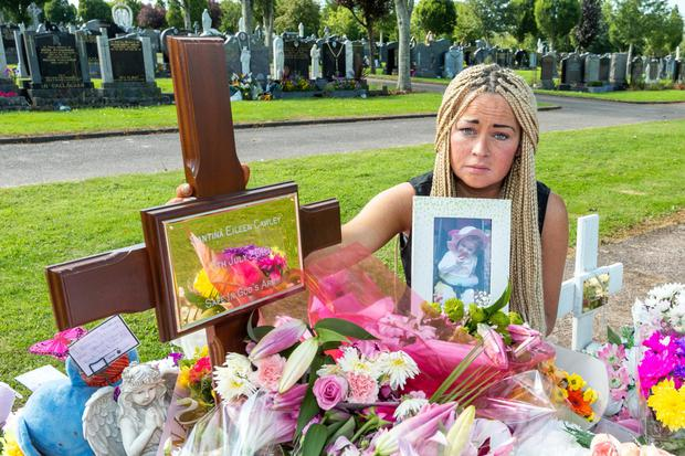 Bridget O'Donoghue tends the grave of her murdered two-year-old daughter Santina Cawley