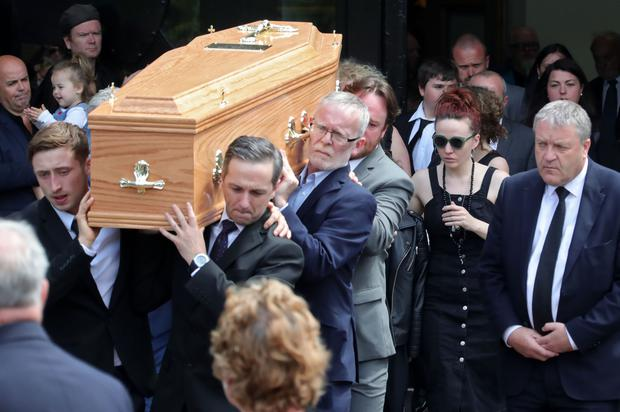 The remains are carried from church followed by Karl Shiels partner, Laura Honan at the funeral of 47 year old Karl Shiels at the Church of Our Lady, Mother of the Church, Castleknock