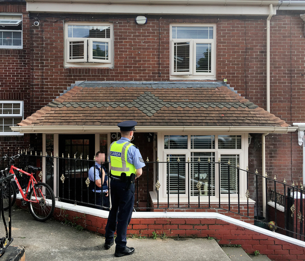 Gardai outside the home of John Hutch on Drumalee Avenue after his fatal fall