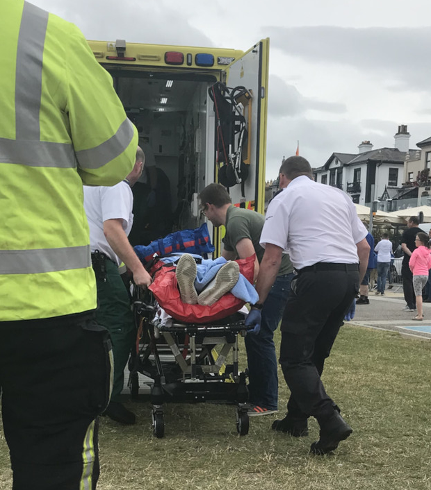 Emergency services attend to the injured
