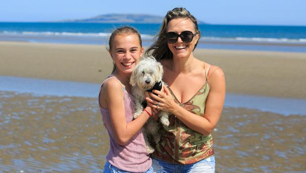 Ava Carr and mum Laura with Oliver at Portmarnock beach