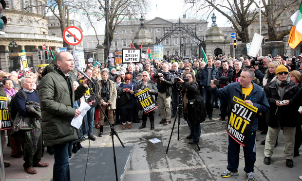 Paul Murphy (left) speaks at a water charges protest in 2016