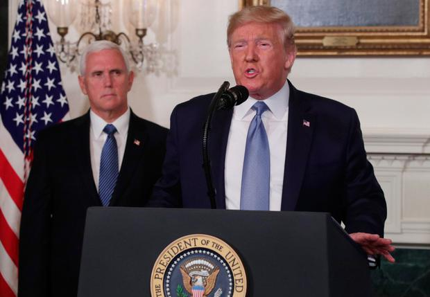 U.S. President Donald Trump makes remarks in the Diplomatic Reception Room of the White House as U.S. Vice President Mike Pence looks on August 5, 2019 in Washington, DC. President Trump delivered remarks on the mass shootings in El Paso, Texas, and Dayton, Ohio, over the weekend.
