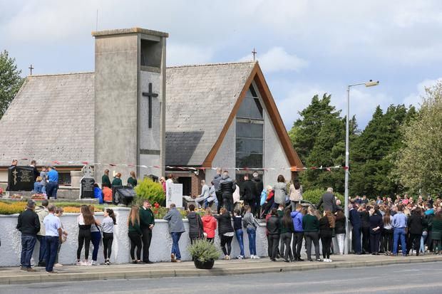 Mourners pictured during the funeral mass of ninteen year old Jessica Moore