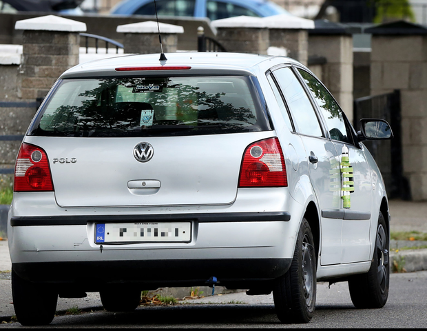 The suspect IED device attached to the door of a car in Coolock.