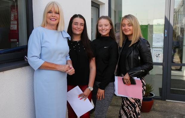 Mary Mitchell O'Connor joined students Beth Clarke, Saoirse Mangan and Heidi Doris as they received their Leaving Cert results.