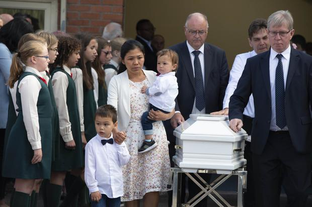 Emmy's parents and siblings at her funeral service in Cork