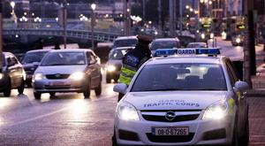 A garda at Wellington Quay as the new 30kph speed limit came into effect – 31 more such zones are planned