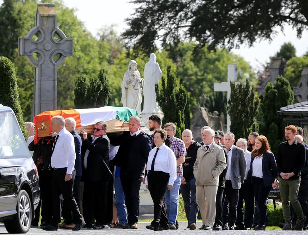 The coffin containing the remains of former IRA man Vincent Donnelly is carried to the crematorium at Glasnevin Cemetery