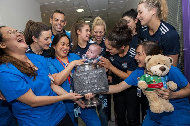 The team meet James Ryan (six months). Photo: Doug O'Connor