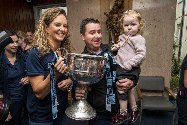 Rachel Ruddy with little Lauren Knight and her dad. Photo: Doug O'Connor