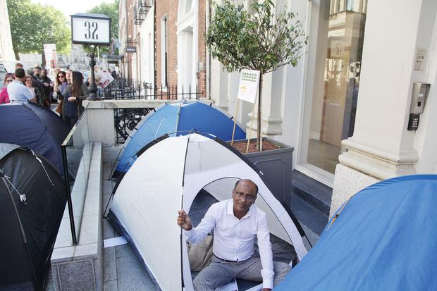 Abu Salem Achy, a member of the Dublin Renters' Union, in a tent outside the Molesworth Street offices of Val Issuer DAC. Photo: Collins