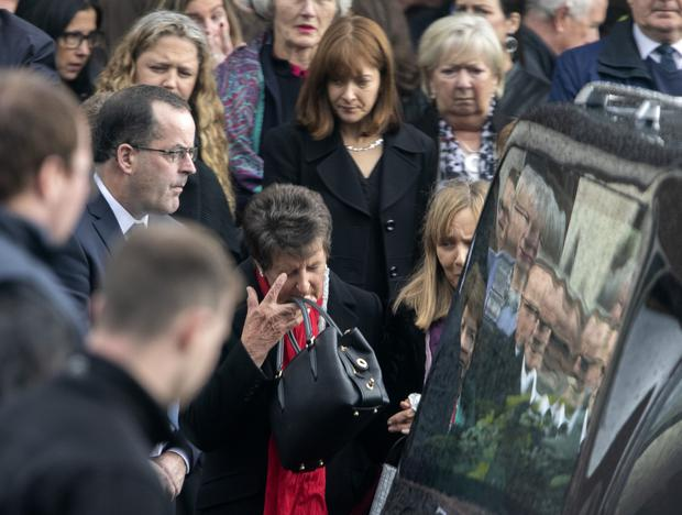 Mourners at the funeral of Dr John Finnan say their final farewells to the man