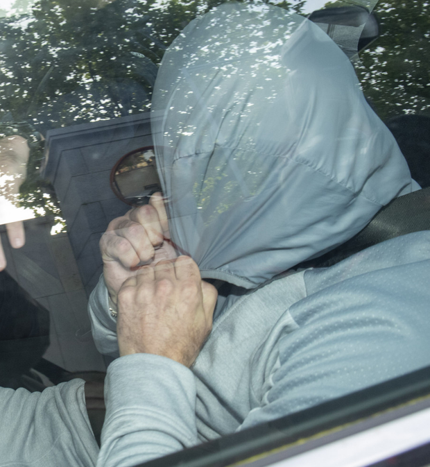 Sean Carlyle arrives at court where he was charged with murdering Vincent Parsons