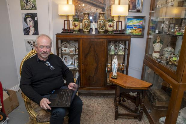 Shop owner Tom O'Connell with the cabinet