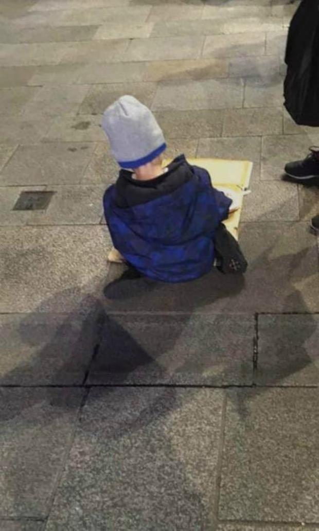 A picture posted by the Homeless Street Cafe showing five-year-old 'Sam' eating his dinner in the street