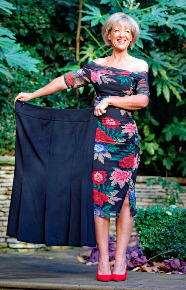 Wendy Deacon celebrates at the London Ritz hotel with one of the skirts she wore when she was 22st 4lbs. Photo: PA
