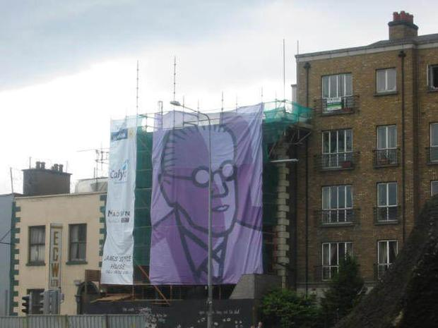 IMAGE OF THE WRITER JAMES JOYCE SHROUDS RENOVATION WORK AT 15 USHER'S ISLAND WHERE THE DEAD IS FAMOUSLY SET