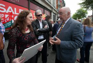 Shop Steward Maureen Deans from Clara Offaly who worked in Clerys for15 years with husband John Deans speaking to Labour Party TD Ruairi Quinn during a protest outside Clerys on O'Connell Street,