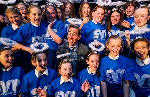 Broadcaster Ryan Tubridy with pupils of St Joseph's school, Tipperary, launching last year's SVP's Christmas appeal