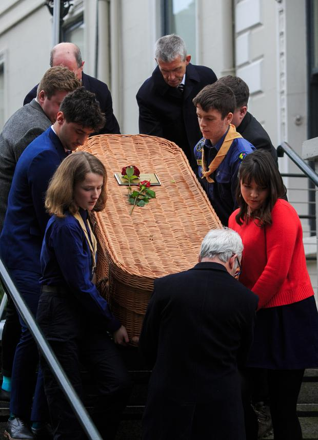 The remains of Cormac O Braonain leave following his funeral at the Mansion house, Dublin