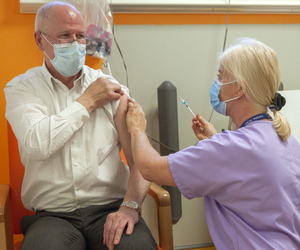 Consultant Professor John Gallagher receives the vaccine