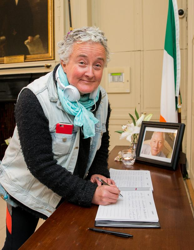 Lorna O'Reilly from Belfield signing a book of condolence for Broadcaster Gay Byrne at the Mansion House, Dublin. Photo: Gareth Chaney/Collins