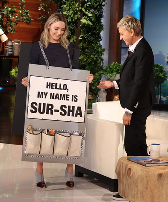 Saoirse appears with Ellen DeGeneres with a sign showing the phonetic spelling of her name