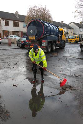 Workmen cleaning up Ashford estate which was flooded in Clondalkin, Dublin