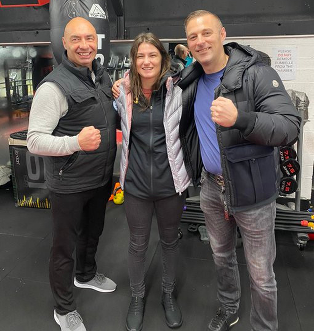 Katie Taylor was photographed with dad Pete (left) in the gym