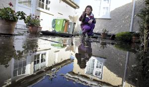 Anne Marie Mulhall picks up the pieces at her home on Nutgrove Avenue in Rathfarnham, Dublin after a night of heavy rain which flooded her house for the second time in three years. The water began streaming into the house at 4am. She has been told that her insurance will not cover the flood damage again and that no sand bags will be provided to her ahead of the forcasted continued heavy rains. Photo Mark Stedman/Photocall Ireland