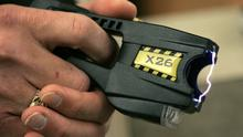 A Taser like the ones being used by the burglars