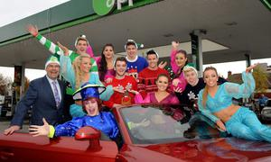 At the launch of APPLEGREEN's sponsorship of Panto 'Aladdin'; Joe Barrett, left, COO of Applegreen, comedian Al Porter, front, who plays 'Nurse Polly', members of the Boy band 'Hometown' and some of the female cast members of Aladdin.  Applegreen Service Station, Mount Merrion, Dublin. Picture: Caroline Quinn