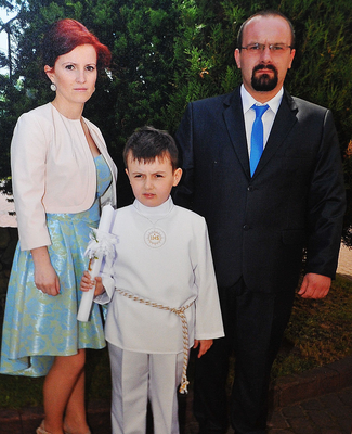 Marcin and Aleksandra with son Piotr at his First Communion