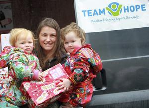 Katie Taylor, world champion boxer and Lily Gordon( 2yrs) and Theodora Mc Donnell (3yrs) lending a hand at one of the collection points in Bray, Co Wicklow for the Team Hope Christmas Shoe box appeal.