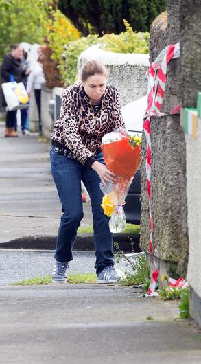 Flowers are laid at the scene