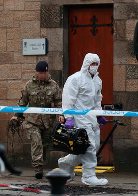 Forensic teams at the University of Glasgow where a suspicious package was found