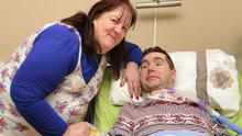 David Garvey has locked-in syndrome and after 2 years in hospital has recieved his wish to come home. David is pictured after spending his first night at home with his family and fiance (pictured) Bernie Dolan.